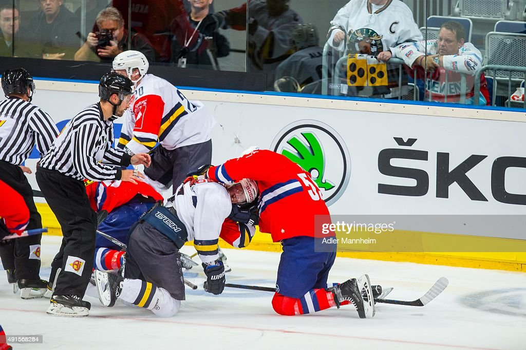 Kim Hirschovits of Espoo Blues in action with Mannheim's Brandon Yip during the Champions Hockey League round of thirtytwo game between Adler...