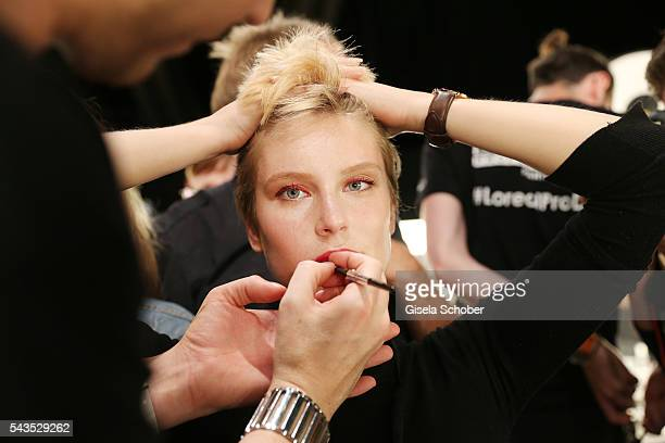 Kim Hnizdo gets prepared backstage ahead of the Minx by Eva Lutz show during the MercedesBenz Fashion Week Berlin Spring/Summer 2017 at Erika Hess...