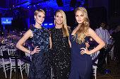 Kim Hnizdo Heidi Klum and Elena Carriere attend 2016 amfAR New York Gala at Cipriani Wall Street on February 10 2016 in New York City