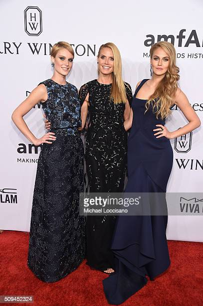 Kim Hnizdo Heidi Klum and Elena Carriere attend 2016 amfAR New York Gala at Cipriani Wall Street on February 10 2016 in New York City