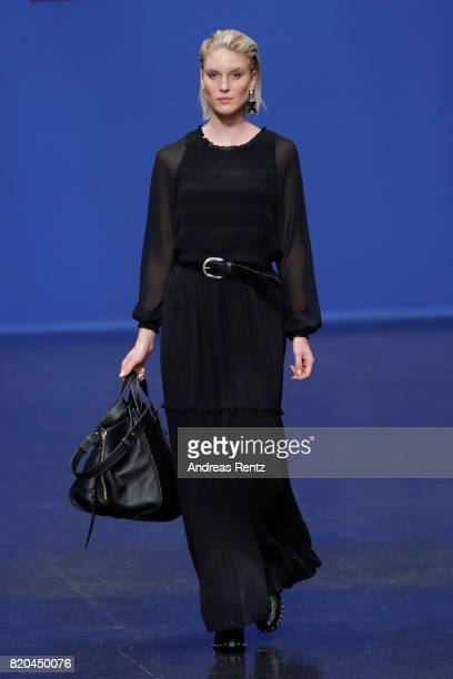 Kim Hnizdo walks the runway at the Breuninger show during Platform Fashion July 2017 at Areal Boehler on July 21 2017 in Duesseldorf Germany