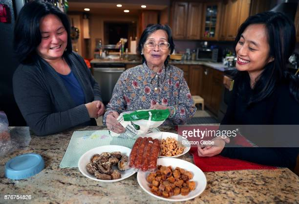 Kim Hua Keung left with her motherinlaw Po Chun ChanKeung and sisterinlaw Winnie Keung sit with all the ingredients they use to make sticky rice a...