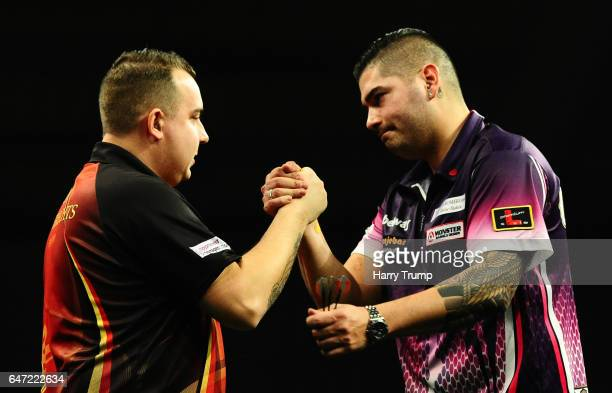 Kim Huybrechts and Jelle Klaasen embrace after their draw during Night Five of the Betway Premier League Darts at Westpoint Arena on March 2 2017 in...