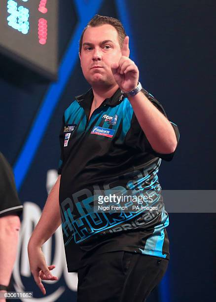 Kim Huybrechts celebrates after winning his match against Max Hopp during day eleven of the William Hill World Darts Championship at Alexandra Palace...