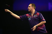 Kim Huybrechts of Belgium in action during his second round match against Ian White of England on Day Eight of the William Hill PDC World Darts...