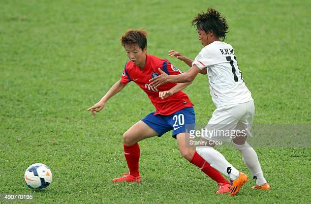 Kim Hye Ri of Korea Republic battles with Khin Moe Wai of Myanmar during the AFC Women's Asian Cup Group B match between Korea Republic and Myanmar...