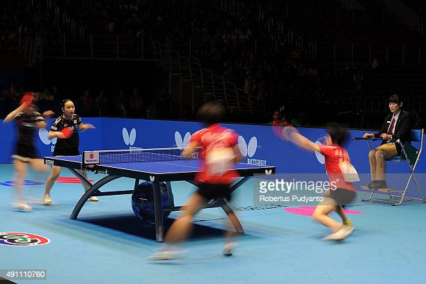 Kim Hye Song and Ri Mi Gyong of DPR Korea compete against Hirano Miu and Ito Mima of Japan during Women's doubles final match of the 22nd 2015 ITTF...