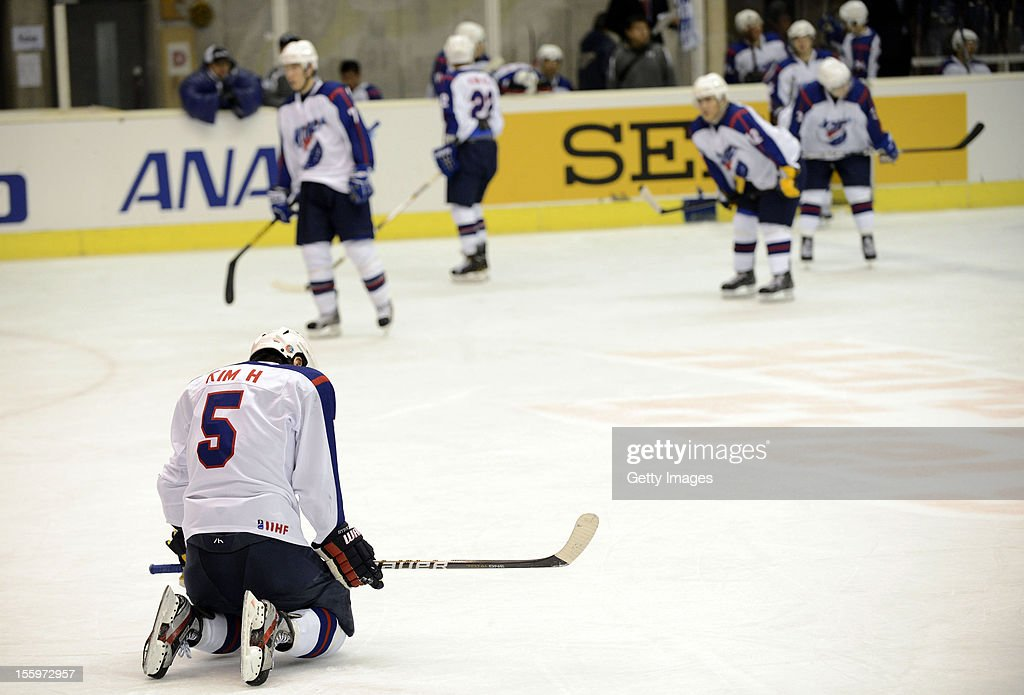 Kim Hyeok of South Korea shows his dejection after losing the Ice Hockey Sochi Olympic Pre-Qualification Group J match between Japan and South Korea at Nikko Kirifuri Ice Arena on November 10, 2012 in Nikko, Japan. Japan won after the over time 3-2.