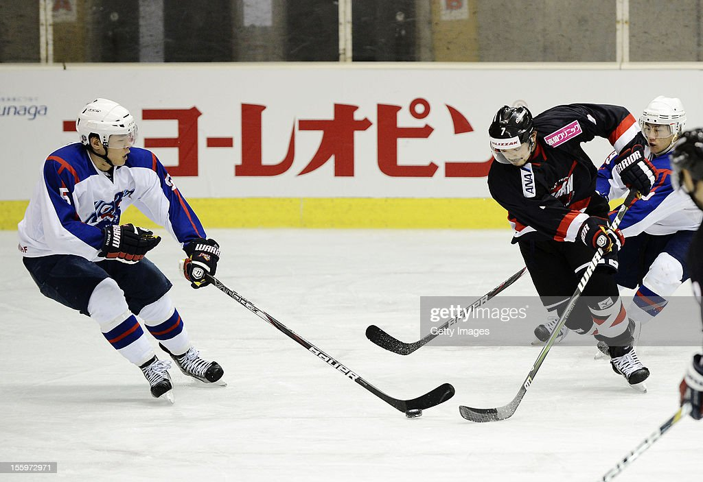 Kim Hyeok #5 of South Korea skates against Masato Domeki #7 of Japan during the Ice Hockey Sochi Olympic Pre-Qualification Group J match between Japan and South Korea at Nikko Kirifuri Ice Arena on November 10, 2012 in Nikko, Tochigi, Japan. Japan won after over time 3-2.
