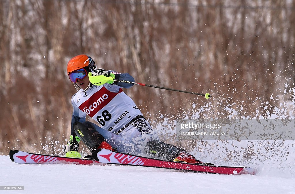 Kim Hyeon-Tae of South Korea attempts to keep balance while skiing down the course during the FIS Ski World Cup 2015/2016 men's slalom competition first run at the Naeba ski resort in Yuzawa town, Niigata prefecture on February 14, 2016. AFP PHOTO / TOSHIFUMI KITAMURA / AFP / TOSHIFUMI KITAMURA