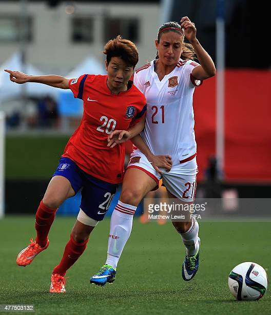 Kim Hyeri of Korea Republic and Alexia Putellas of Spain challenge for the ball during the FIFA Women's World Cup 2015 Group E match between Korea...