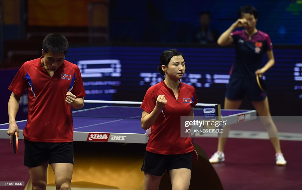 Kim Hyok Bong (R) and Kim Jong of North Korea react as they win their mixed doubles quarter final match against Yan An and Wu Yang of China at the 2015 World Table Tennis Championships at the Suzhou International Expo Center in Suzhou, Jiangsu province on April 29, 2015.