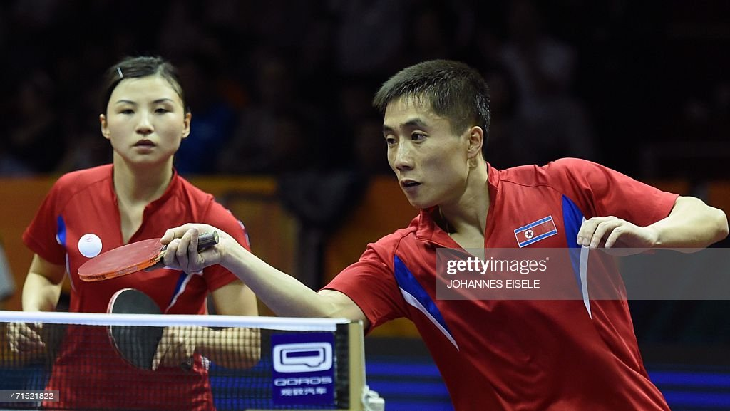 Kim Hyok Bong (R) and Kim Jong of North Korea serve during their mixed double quarter final match against Yan An and Wu Yang of China at the 2015 World Table Tennis Championships at the Suzhou International Expo Center in Suzhou, Jiangsu province on April 29, 2015.