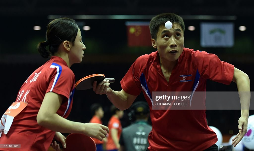 Kim Hyok Bong (R) and Kim Jong of North Korea serve during their mixed doubles quarter final match against Yan An and Wu Yang of China at the 2015 World Table Tennis Championships at the Suzhou International Expo Center in Suzhou, Jiangsu province on April 29, 2015.