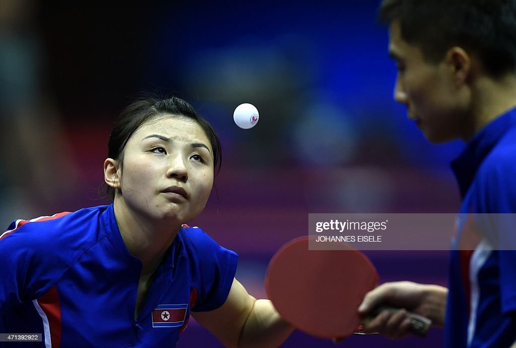 Kim Hyok Bong and <a gi-track='captionPersonalityLinkClicked' href=/galleries/search?phrase=Kim+Jong+-+Table+Tennis+Player&family=editorial&specificpeople=5499597 ng-click='$event.stopPropagation()'>Kim Jong</a> of South Korea serve during their mixed doubles match against Diogo Chen and Leila Oliveira of Portugal in the 2015 World Table Tennis Championships at the Suzhou International Expo Center in Suzhou, Jiangsu province on April 28, 2015.