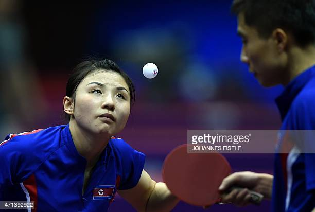 Kim Hyok Bong and Kim Jong of South Korea serve during their mixed doubles match against Diogo Chen and Leila Oliveira of Portugal in the 2015 World...