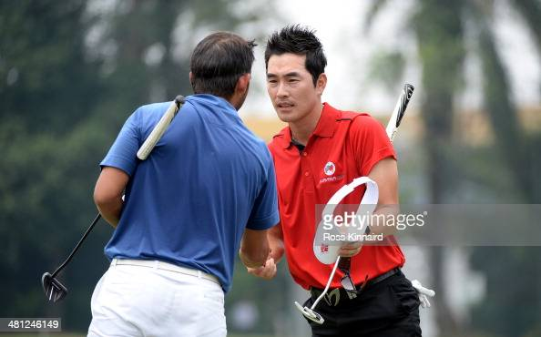Kim Hyung Sung of Team Asia is congratulated by Pablo Larrazabal of Team Europe during the single matches on day three of the EurAsia Cup at...