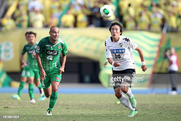 Kim HyunHun of JEF United Chiba and Naohiro Takahara of Tokyo Verdy compete for the ball during the JLeague second division match between Tokyo Verdy...