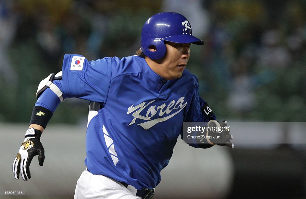Kim Hyun-Soo of South Korea run into first base in the seventh inning during the World Baseball Classic First Round Group B match between South Korea and Australia at Intercontinental Baseball Stadium on March 4, 2013 in Taichung, Taiwan.