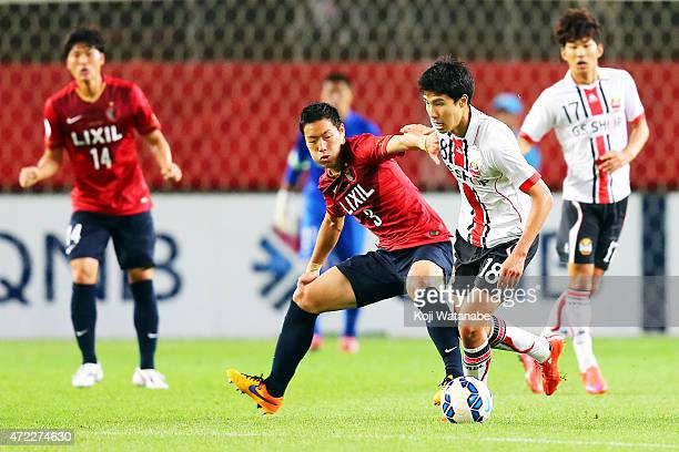 Kim Hyunsung of FC Seoul and Gen Shoji of Kashima Antlers compete for the ball during the AFC Champions League Group H match between Kashima Antlers...