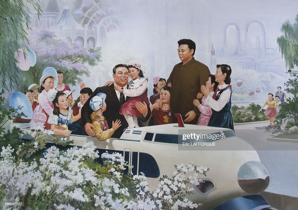 Kim Il Sung and Kim Jong Il on a propaganda poster, on May 10, 2010 in Pyonyang, North Korea.