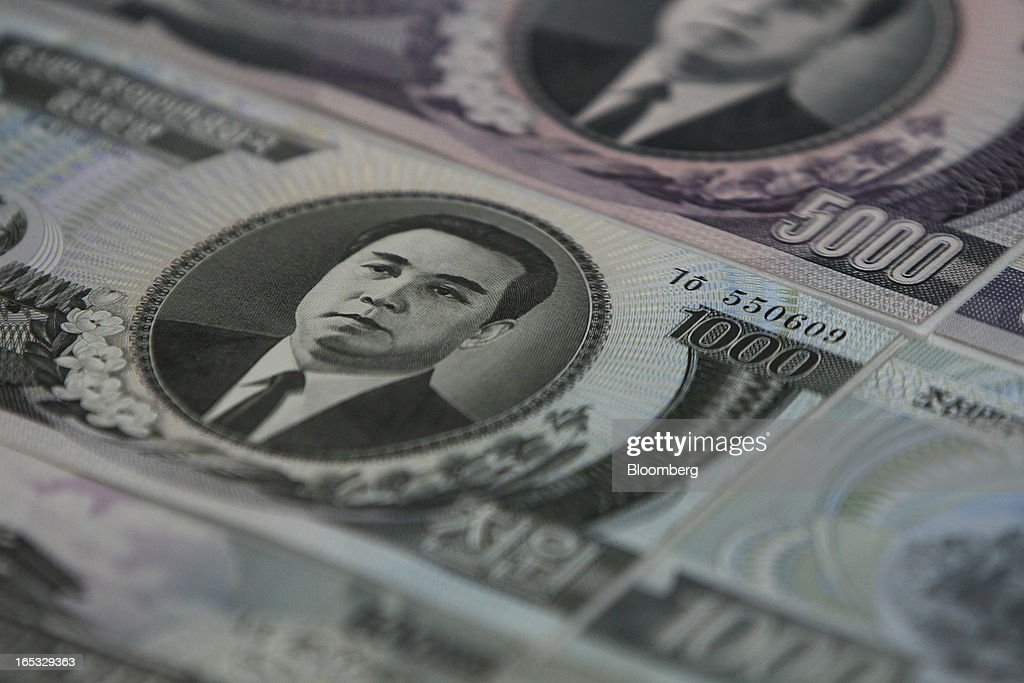 Kim Il Sung, founder of North Korea, is seen on North Korean won banknotes displayed at the Odusan Unification Observatory near the demilitarized zone (DMZ) in Paju, South Korea, on Wednesday, April 3, 2013. North Korea prevented South Korean workers from entering a jointly run industrial park today, adding to tensions after saying it will restart a mothballed nuclear plant and threatening to attack its southern neighbor. Photographer: SeongJoon Cho/Bloomberg via Getty Images