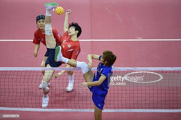 Kim IsEul of South Korea jumps for the ball against Wanwisa Jankaen of Thailand during their women's gold medal final event of the 17th Asian Games...