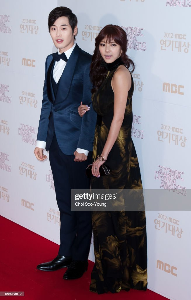 Kim Jae-Won and Son Dam-Bi pose for photographs upon arrival during the 2012 MBC Drama Awards at MBC Open Hall on December 30, 2012 in Seoul, South Korea.