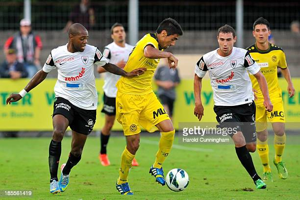 Kim Jaggy of FC Aarau and Gonzalo Zarate of BSC Young Boys and Dante Senger FC Aarau in action during the Swiss Super League match between FC Aarau v...