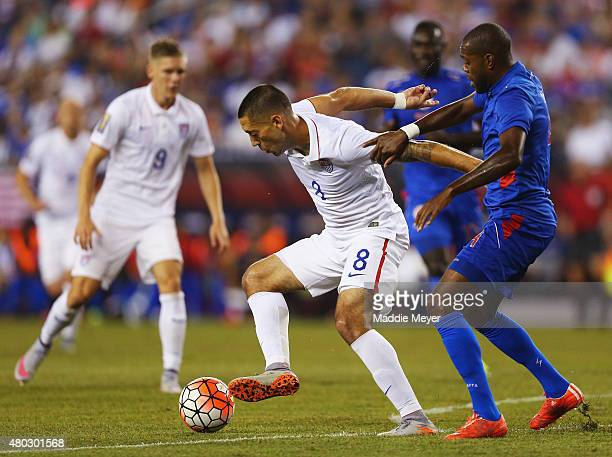 Kim Jaggy of Haiti defends Clint Dempsey of United States during the 2015 CONCACAF Gold Cup Group A match between United States and Haiti at Gillette...