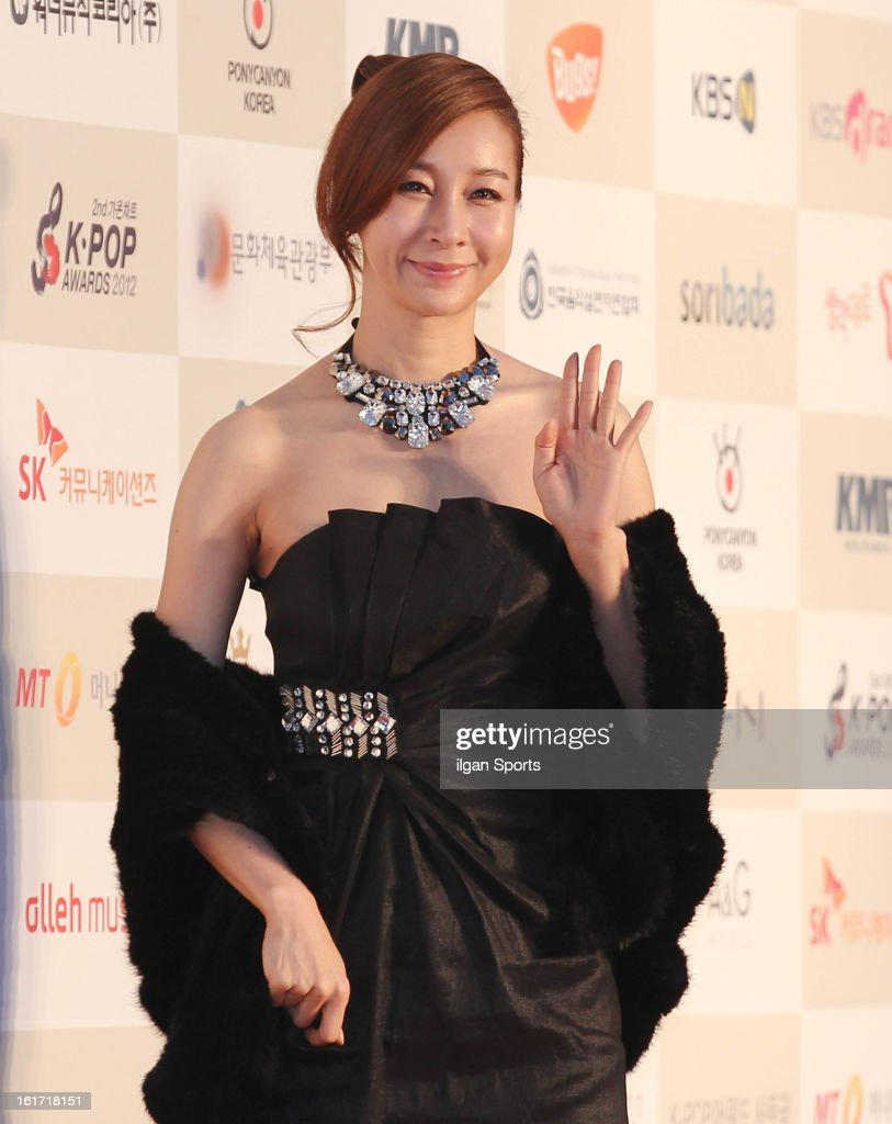 Kim Ji-Hyun poses for photographs upon arrival during '2nd Gaonchart K-pop Awards' at Olympic Hall on February 13, 2013 in Seoul, South Korea.