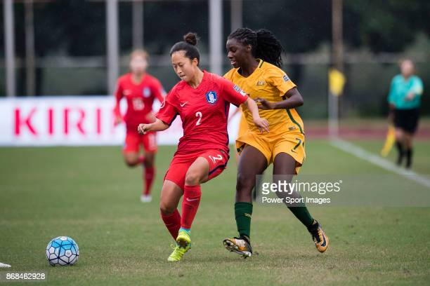 Kim Jin Hui of South Korea fights for the ball with Princess IbiniIsei of Australia during their AFC U19 Women's Championship 2017 Group Stage B...