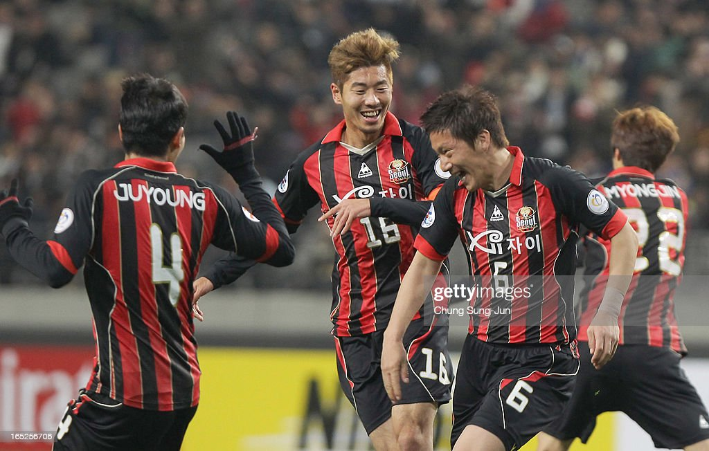 Kim Jin-Kyu of FC Seoul celebrates after score with Kim Ju-Young and Ha Dae-Sung during the AFC Champions League Group E match between FC Seoul and Vegalta Sendai at Seoul World Cup Stadium on April 2, 2013 in Seoul, South Korea.