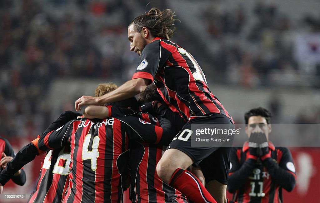 Kim Jin-Kyu of FC Seoul celebrates after score with Kim Ju-Young and Dejan Damjanovic during the AFC Champions League Group E match between FC Seoul and Vegalta Sendai at Seoul World Cup Stadium on April 2, 2013 in Seoul, South Korea.