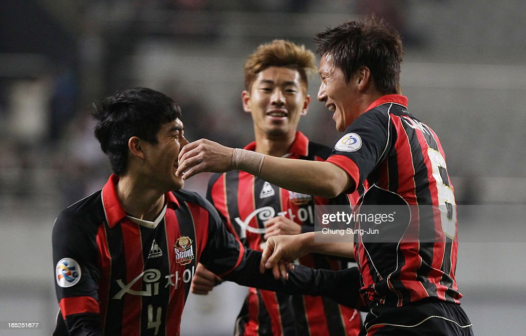 Kim Jin-Kyu of FC Seoul celebrates after score with Kim Ju-Young during the AFC Champions League Group E match between FC Seoul and Vegalta Sendai at Seoul World Cup Stadium on April 2, 2013 in Seoul, South Korea.