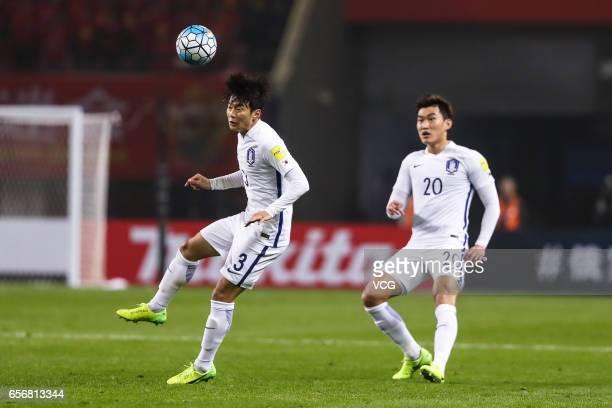 Kim Jinsu and Jang Hyunsoo of South Korea follow the ball during the 2018 FIFA World Cup Qualifying group match between China and South Korea at...