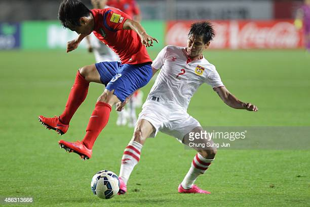 Kim JinSu of South Korea compete for the ball with Phommapanya Saynakhonevieng of Laos during the 2018 FIFA World Cup Qualifier Round 2 Group G match...