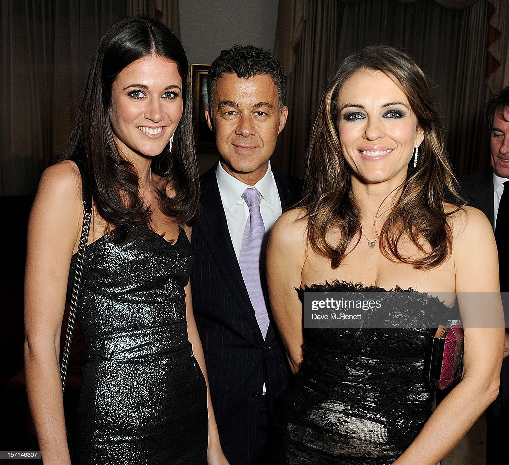 (L to R) Kim Johnson, Omer Karacan and Elizabeth Hurley attend a dinner celebrating the launch of 'Valentino: Master Of Couture', the new exhibition showing at Somerset House from November 29, 2012 to March 3, 2013, at the Italian Embassy on November 28, 2012 in London, England.