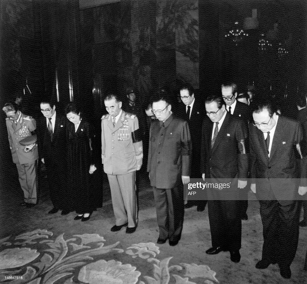 Kim Jong Il, son of late North Korean President Kim Il Sung (C) and high ranking officials, Defense Minister O Jin Wu (L) and Prime Minister Kang Song San (R), pay their last respects in front of Kim Il Sung's body at the presidential palace in Pyongyang, North Korea, on July 11, 1994. After his death, Kim Il-sung is named 'eternal president' of Democratic People's Republic of Korea.