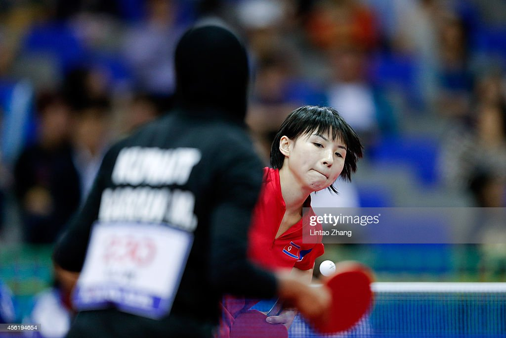 Kim Jong of North Korea competing against Maryam S B A Abdulraheem of Kuwait in Table Tennis Women's Team Preliminary Round Group D during day eight of the 2014 Asian Games at Suwon Gymnasium on September 27, 2014 in Incheon, South Korea.