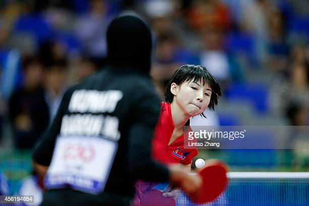 Kim Jong of North Korea competing against Maryam S B A Abdulraheem of Kuwait in Table Tennis Women's Team Preliminary Round Group D during day eight...