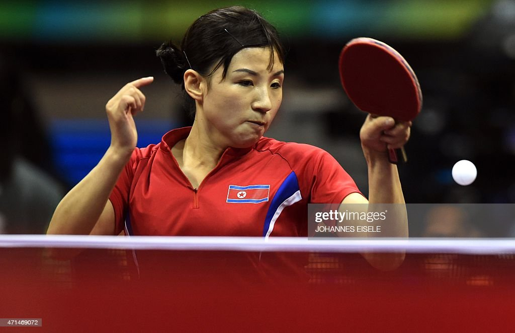 Kim Jong of North Korea hits a return during her women's singles match against Hirano Miu of Japan at the 2015 World Table Tennis Championships in Suzhou on April 29, 2015.