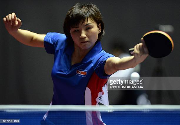 Kim Jong of North Korea returns the ball towards Natalia Partyka of Poland during their women's singles round three match of the 2014 World Team...