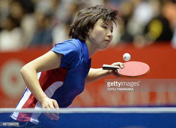 Kim Jong of North Korea serves against Elizabeta Samara of Romania during their women's singles round two match of the 2014 World Team Table Tennis...