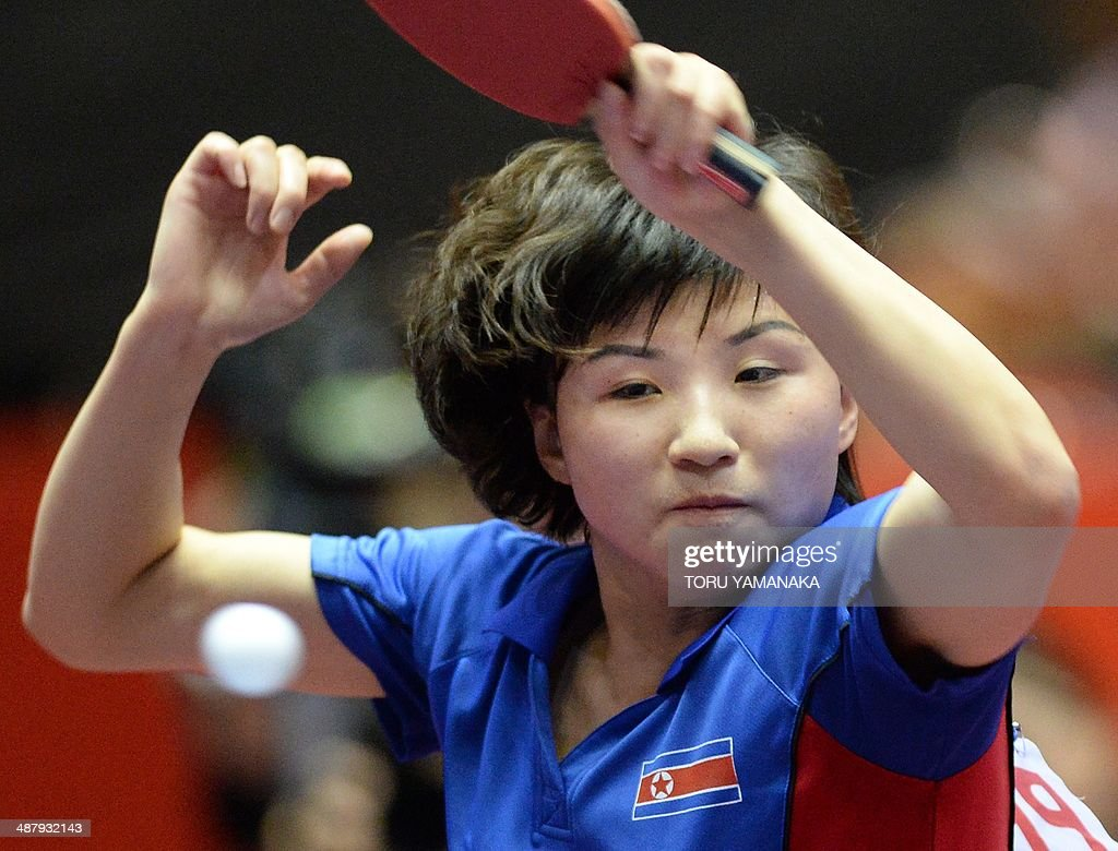 Kim Jong of North Korea smashes the ball against Zhu Yuling of China during their women's team quarter-final match of the 2014 World Team Table Tennis Championships in Tokyo on May 3, 2014. AFP PHOTO/Toru YAMANAKA