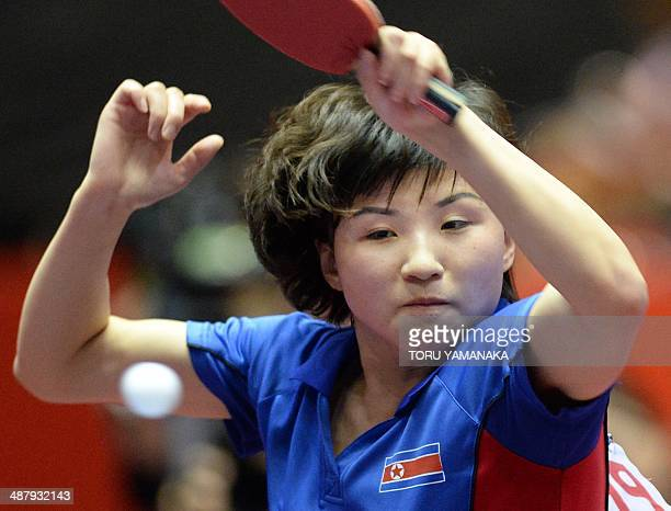 Kim Jong of North Korea smashes the ball against Zhu Yuling of China during their women's team quarterfinal match of the 2014 World Team Table Tennis...