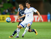 Kim Jongmin of Suwon and Daniel Georgievski of the Victory compete for the ball during the AFC Champions League match between the Melbourne Victory...
