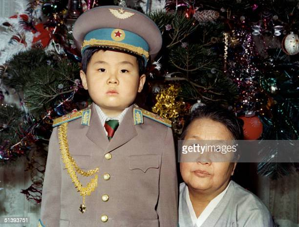 Kim JongNam dressed in an army uniform poses with his maternal grandmother in January 1975 in an unknown place Kim JongNam is believed to be the...