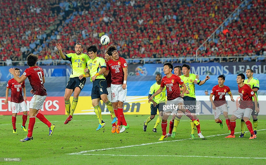 Kim Ju Yong of FC Seoul competes for the ball with Kim Yong Gwon of Guangzhou Evergrande during the AFC Champions League Final 2nd leg match between Guangzhou Evergrande and FC Seoul at Guangzhou Tianhe Sport Center Stadium on November 9, 2013 in Guangzhou, China.