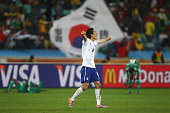 Kim JungWoo of South Korea celebrates after a draw gives them victory and progress to round two in the 2010 FIFA World Cup South Africa Group B match...